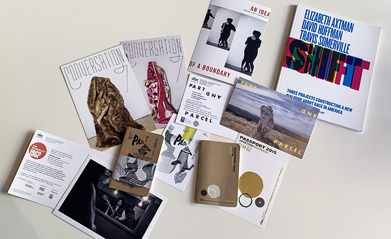A collection of postcards and publications produced by SFAC Galleries