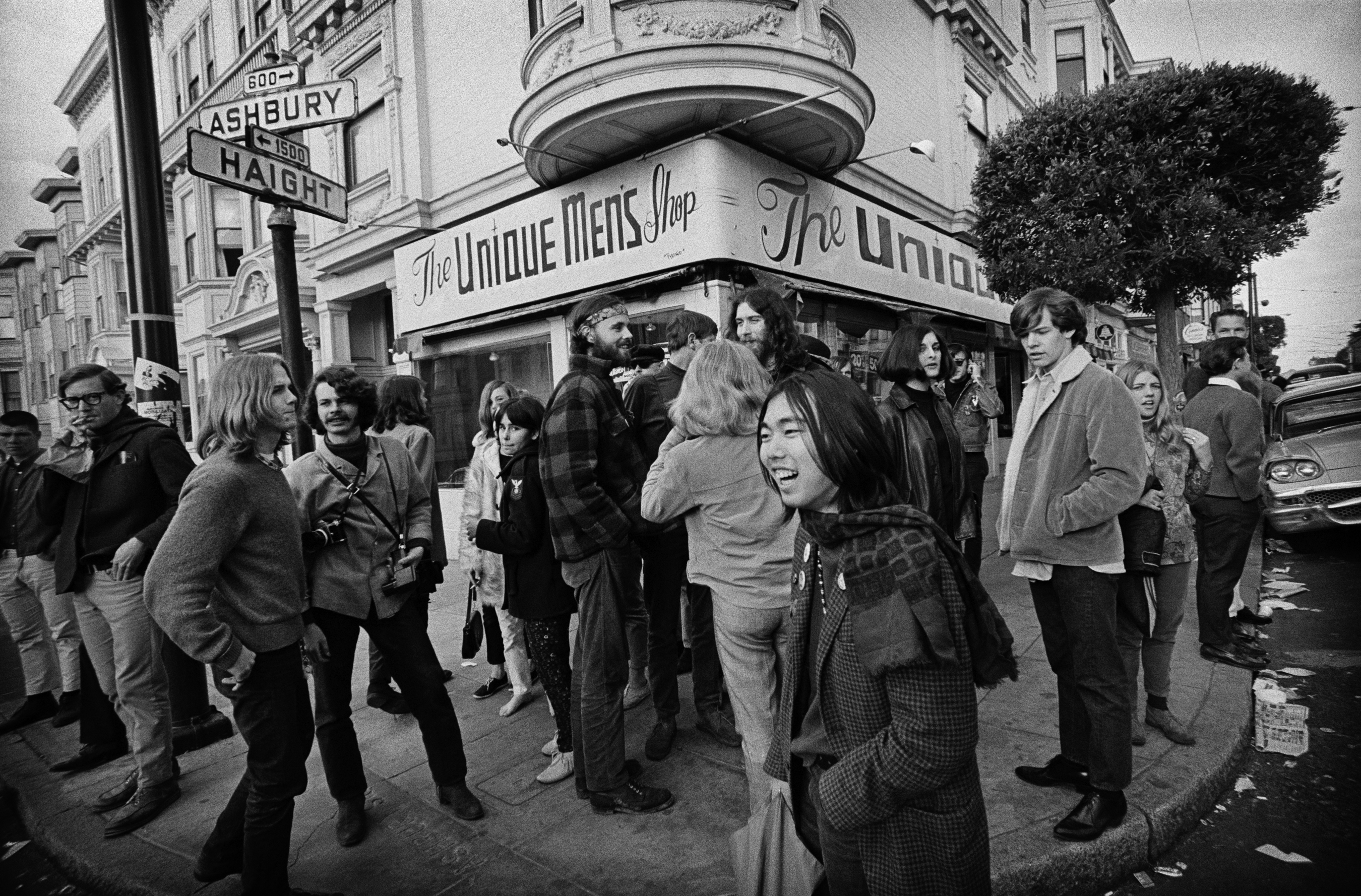 A crowd at the corner of Haight and Ashbury Streets
