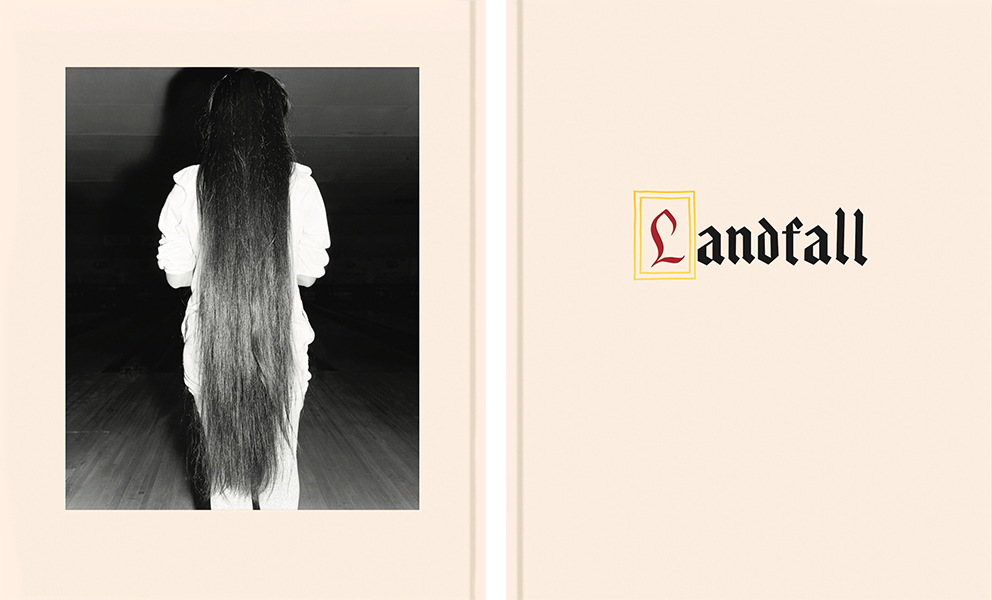 image of  photo book called Landfall with back cover image of the back of a girl with knee length hair