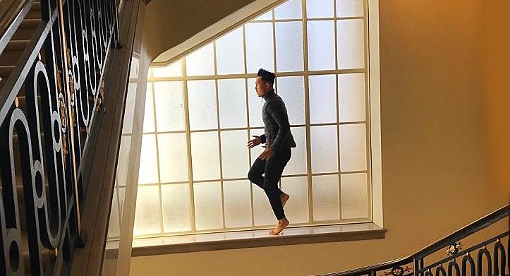 image of man dancing on window ledge.