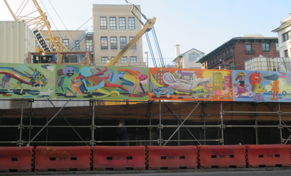 Colorful mural by Jason Jagel on the construction barrier at the new Chinatown Centeral Subway station