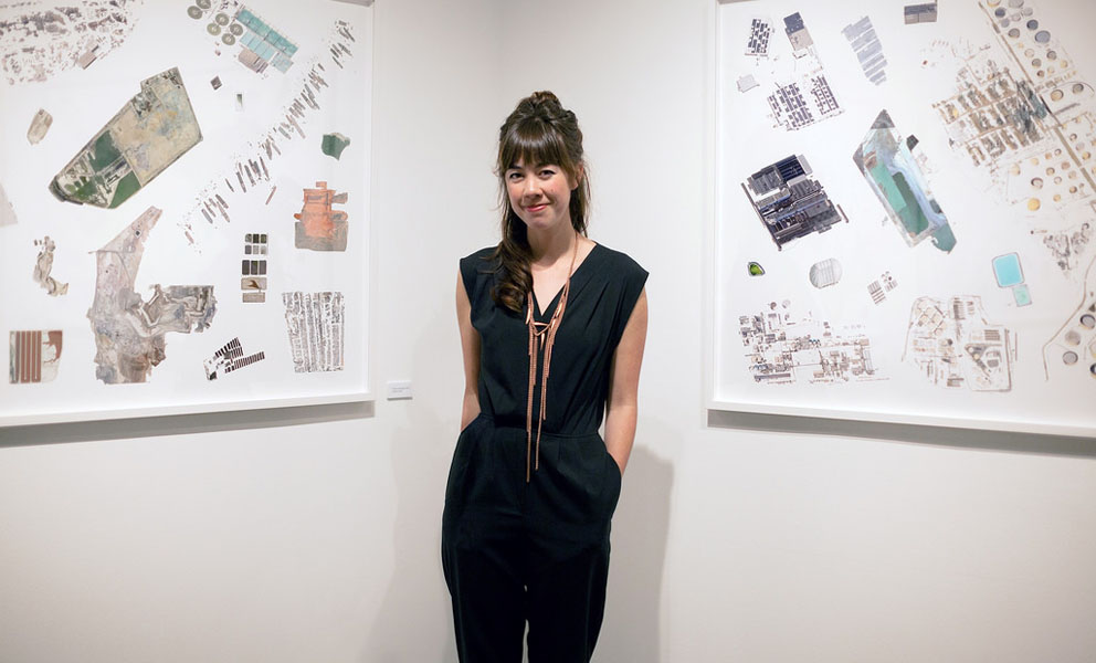 Artist Jenny Odell standing in front of her artwork.