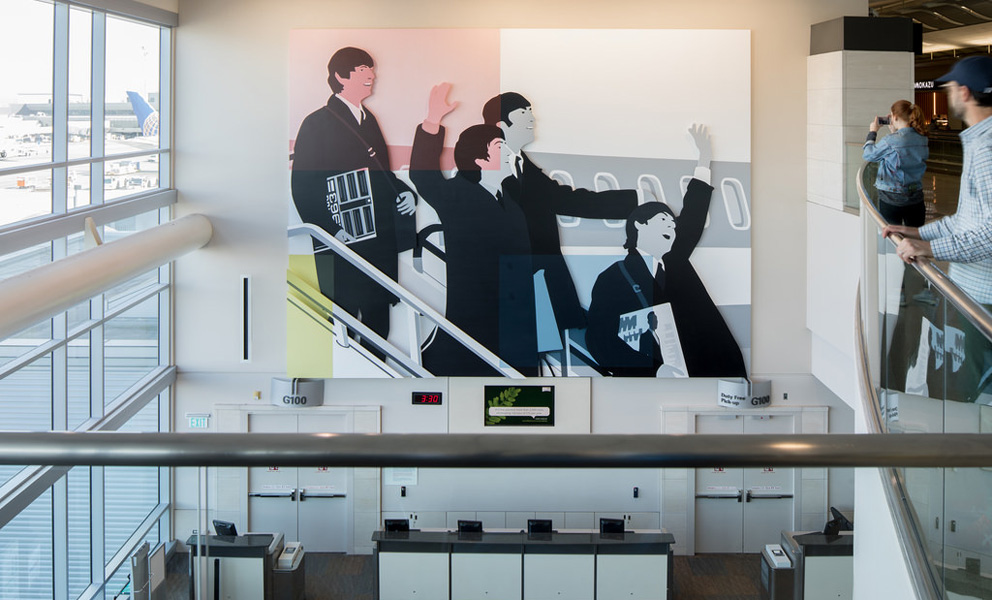 Installation by Kota Ezawa at an airport gate featuring The Beatles coming off a plane overlaid with a composition by Piet Mondrian a famous abstract painter
