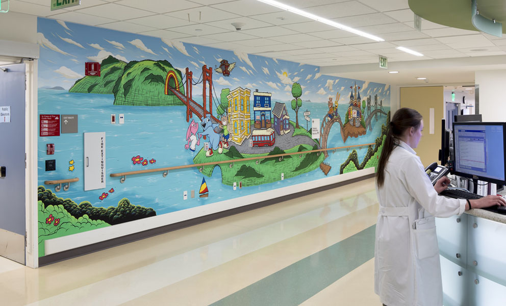 Colorful mural by Simon Norris. Mural features cartoon-like characters and San Francisco icons like the GG bridge.