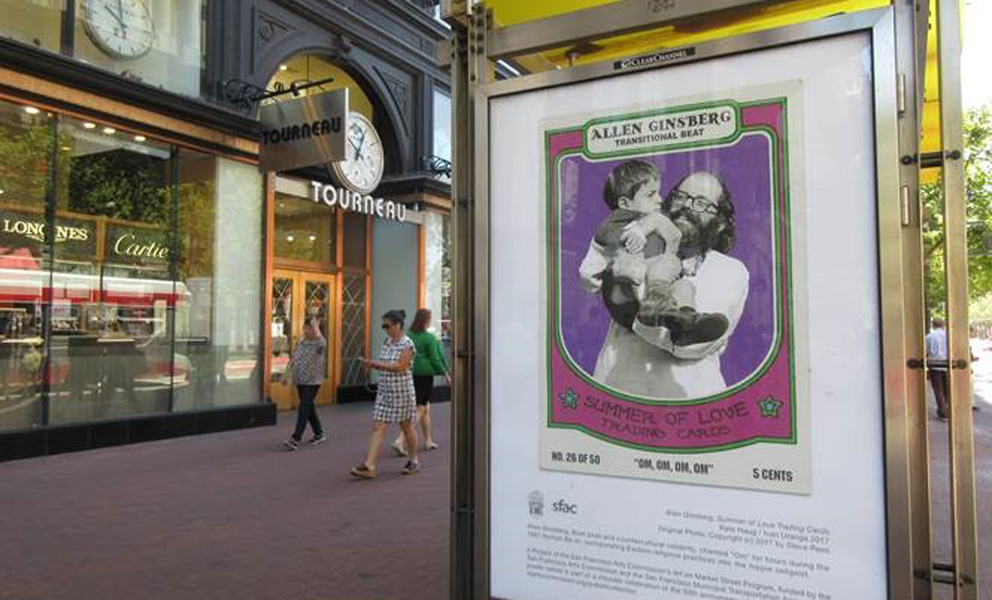 Kiosk poster close up of Allen Ginsburg holding a child