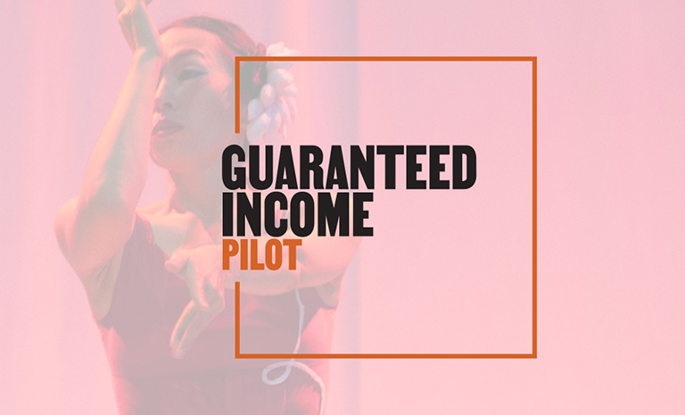 "A faded image, tinted red, of a female dancer. Overlaid over the image is the text ""guaranteed income pilot."""