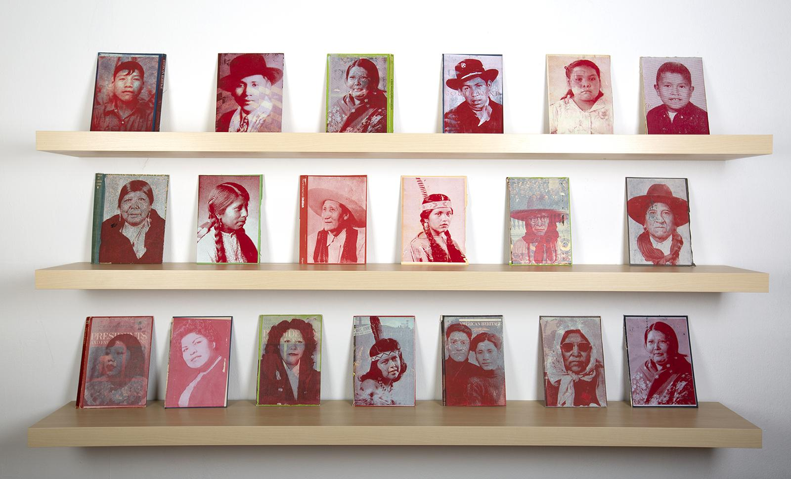 Three shelves with 19 works featuring portraits from an Indigenous family archive screen printed onto book pages