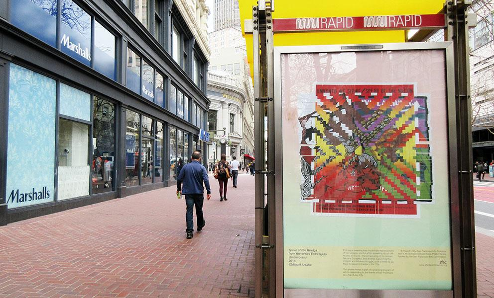 Miguel Arzabe's poster in the bus kiosk on Market Street